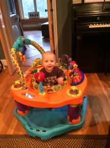 I was going to take a pic of Ethan in his dirty PJs.  But I didn't have time for that.  Here's one that Eliza took on my phone.  He spends a lot of time in his exersaucer.